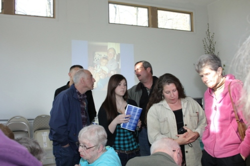 Family members gather before the Dedication