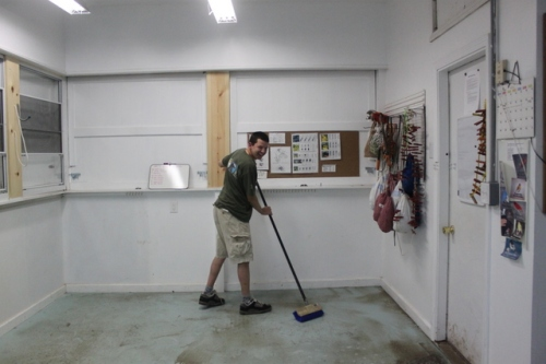Ryan getting a week's worth of mud off the banding lab's floor!