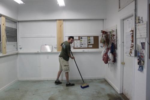 Ryan getting a week's worth of mud off the banding lab's floor!