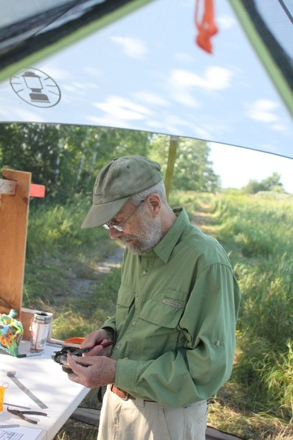Warren King Banding A Song Sparrow                                        Photo by Ryan Kayhart