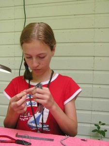 Cici bands a Tufted Titmouse during the 2012 Summer Teen Bander Training Class