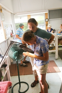 Jenna & Megan Using the Magnification to Age the Ovenbird by Skulling Photo by John Waud