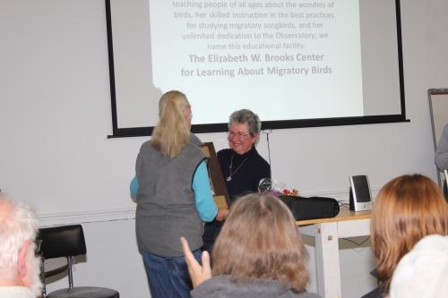 Betsy receives her dedication plaque from board member Chita McKinney.